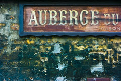 Old french hotel signage. Old hotel signage in Paris, France. Auberge means hotel and maison means house Royalty Free Stock Images