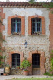 Old french house exterior, made by brick, with door and windows as background Royalty Free Stock Photos