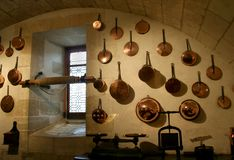 Old French Kitchen and copper cookware. Photograph of the old vaulted kitchen in the Renaissance Chateau de Chenonceau, located on the river Cher, in the Loire royalty free stock photography