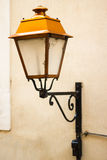 Old french lamp on wall. In Gap Stock Photos