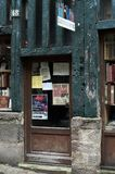 An old French library presents books and latest magazines on its door and windows. royalty free stock image