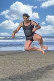 Old French Man Jump On The Beach Stock Photo