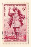 An old french postage stamp with an actor from the novel gargantua by Francois Rabelais stock images