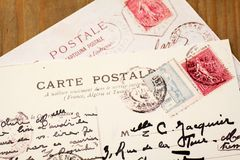 Old French Postcards. Two old French Postcards on wooden desk stock photography
