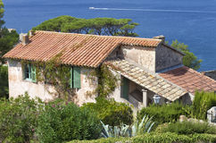 Old French rustic villa by the sea with garden Royalty Free Stock Images