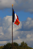 Old French state flag tricolor. Blue sky background royalty free stock images