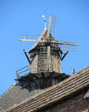 Old French Windmill. An old wooden widmill situated on the top of a tower at Haut-Koenigsbourg Castle in Alsace, France Stock Photography