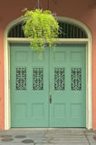 Old freshly painted doors in French Quarter near Bourbon Street in New Orleans, Louisiana stock photography
