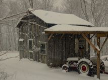 Old Friends, Barn and Tractor in snow Stock Photos