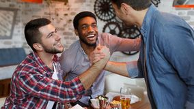 Old Friends Meeting. Mates Meet In Beer Pub. Greeting Each Other royalty free stock photography