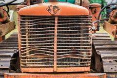 Old Front Bulldozer. Front part of a vintage bulldozer shoing it`s grill royalty free stock photography