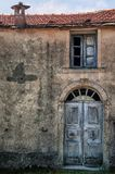 Old front door. Of an abandonment farmhouse in Corsica (France Royalty Free Stock Photos