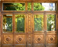 Old front wooden doors with windows and with patterns stock images