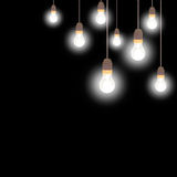 Old frosted glass light bulbs over black. Stock Image