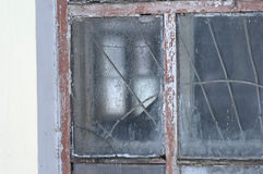 Old frosted window. Old frosted window of an abandoned building in winter Royalty Free Stock Images
