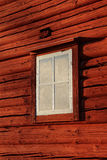 Old frosty window on old red Swedish cabin Stock Photography