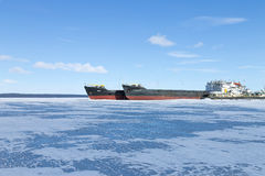 Old frozen cargo ships in the port at winter time Stock Photos