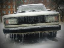 Frozen with icicles. Old frozen with icicles car face in cold winter weather Royalty Free Stock Image