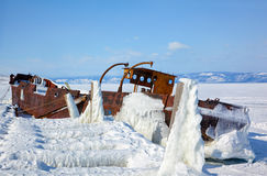 Old frozen ship on the bank of Olkhon island on siberian lake Ba Stock Photo