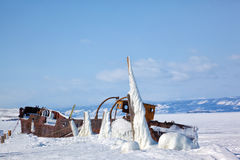 Old frozen ship on the bank of Olkhon island on siberian lake Ba Royalty Free Stock Images