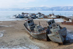 Old frozen ship on the bank of Olkhon island on siberian lake Baikal Stock Image