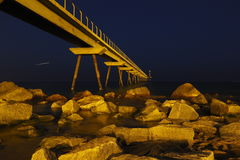 Old fuel bridge over the sea Badalona city Royalty Free Stock Image