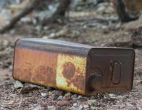 Old fuel can abandoned in the woods stock photo