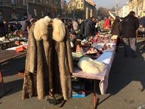 Old fur coat at flea market. Royalty Free Stock Photo