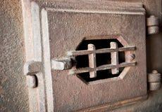 Old furnace door Stock Images