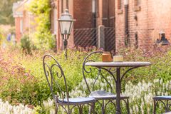 Old furniture in a beautiful natural garden stock photo
