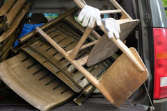 Old Furniture In Car. Car boot loaded with old furniture, cropped outdoor photo Stock Images