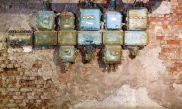 Old fuse box in an old abandoned factory. Old fuse boxes in an old abandoned factory stock photography