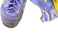 Old futsal shoes on white background football sportware object isolated
