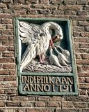Old gable stone with mother pelican injuring her own chest to feed her starving young with her own blood, Amsterdam. Pictured is an old gable stone with a mother royalty free stock photo
