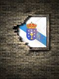 Old Galicia flag in brick wall. 3d rendering of a Galicia Spanish Community flag over a rusty metallic plate embedded on an old brick wall Stock Photos