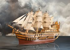 Old galleon sailing in dark sea. Old galleon sailing on dark sea Royalty Free Stock Images