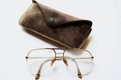 Old galsses case. Old glasses with brown case Royalty Free Stock Images