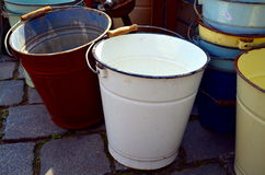 Old galvanised bucket standing at a street Stock Photos