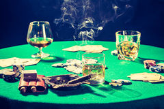 Old gambling table with whiskey, cigar and cards Stock Photo