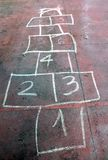 Old game of the staircase with the numbers drawn with a chalk Royalty Free Stock Photos