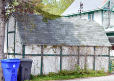Old garage or barn with new recycle bins in front Royalty Free Stock Photography