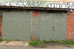 Old garage. Old brick garage with iron gates Stock Photo