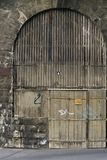 Old garage door (3113a). Old door in an old brick wall - entrance to a garage Royalty Free Stock Images