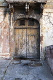 Old garage door with cracked driveway Stock Photo