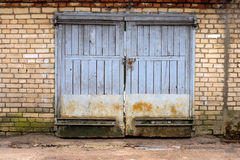 Old garage gate in the brick wall Stock Images