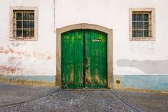 Old garage green door Stock Photos