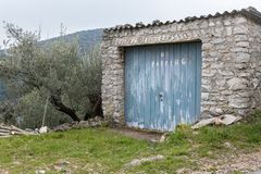 Old garage made of stone with No Parking written on door. Croatia Island Cres royalty free stock photography