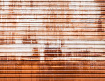 Old Garage Roller Door Streaked with Rust and Paint. Old and worn off white corrugated garage roller door with big streaks of rust as well red paint, raindrops Stock Photos