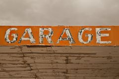 Old Garage Sign in the Desert royalty free stock photos