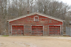 Old Garage. Old three car garage, weathered red paint Stock Photo